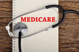 White notebook with the word Medicare printed on it, surrounded by a stethescope.