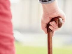 Closeup of a hand on a walking cane